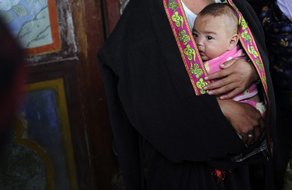 Kinijoje - išpuolis prieš vieno vaiko politikos priežiūros pareigūnus (yra žuvusių)