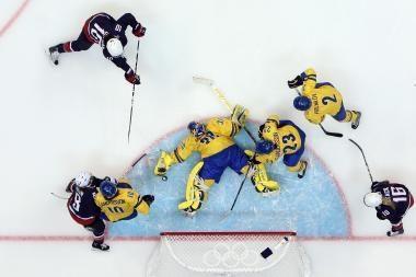 Olimpinio moterų ledo ritulio turnyro finale kovos JAV ir Kanada