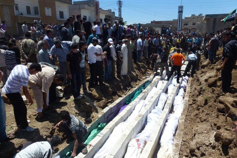"""Per naujas """"žudynes"""" Sirijoje nužudyta 100 žmonių"""