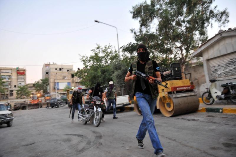 B.al Assadas nurodė cheminį ginklą sutelkti prie šalies sienų