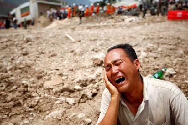 Kinai gedės daugiau nei 1 200 nuo žemės nuošliaužų žuvusių tautiečių