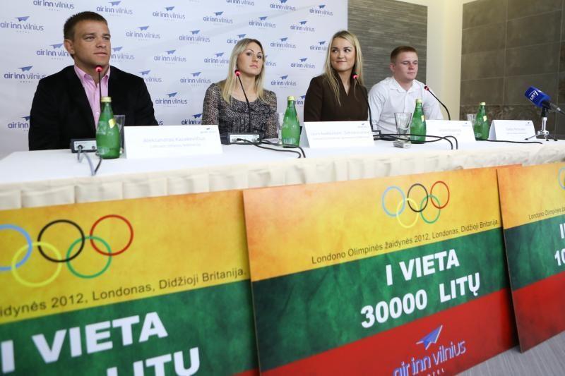 Medalius iškovojusiems olimpiečiams įteiktos premijos