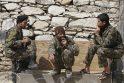 NATO vadovas smerkia prie mirtininkų palaikų pozavusius karius