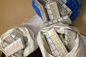 Kontrabandinės cigaretės buvo slepiamos silose