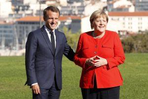 Ginče dėl pabėgėlių politikos Prancūzijos prezidentas parėmė Vokietijos kanclerę