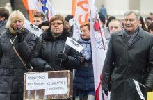 Mokytojai nesutaria dėl etatinio darbo apmokėjimo, baiminasi atleidimų